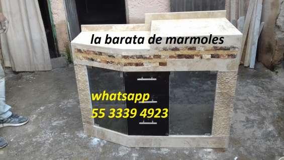 Mueble de marmol con lavabo integrado